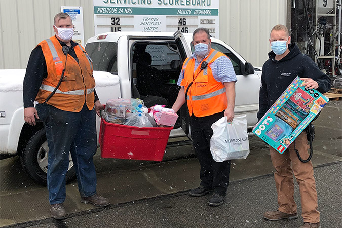 Darius LaPierre, right, and coworkers load donations.